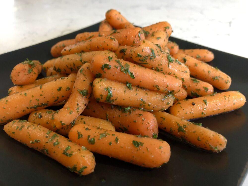 A close up image of honey glazed carrots.