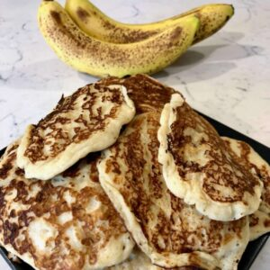 A close up image of banana pancakes that were created using this recipe